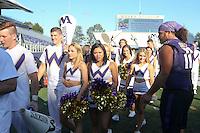AUG 16, 2014:  University of Washington cheerleader Jade Carson during Football Picture Day at Husky Stadium in Seattle, Washington