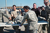 Fort Hood, TX - November 5, 2009 -- First responders use a table as a stretcher to transport a wounded Soldier to an awaiting ambulance at Fort Hood, Texas, Thursday, November 5, 2009. .Mandatory Credit: Jason R. Krawczyk - U.S. Army via CNP