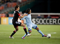 Branko Boskovic (8) of D.C. United  tries to take the ball away from Roger Espinoza (15) of Sporting KC during the game at RFK Stadium in Washington, DC.  Sporting KC defeated D.C. United, 1-0.