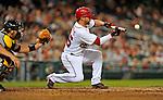 17 May 2012: Washington Nationals catcher Jesus Flores lays down a sacrifice bunt against the Pittsburgh Pirates at Nationals Park in Washington, DC. The Pirates defeated the Nationals 5-3 in the second game of their 2-game series. Mandatory Credit: Ed Wolfstein Photo