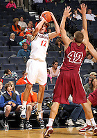 Nov 6, 2010; Charlottesville, VA, USA; Virginia Cavaliers g Joe Harris (12) shoots over Roanoke College f Joey Leech (42) Saturday afternoon in exhibition action at John Paul Jones Arena. The Virginia men's basketball team recorded an 82-50 victory over Roanoke College.