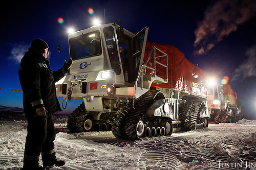 "A worker from gas and oil exploration company ""Seismorazvedka"" guides an all-terrain ""Vibrator"" in the Arctic tundra in the Nenets Autonomous Region. The vehicle, made by French company Sercel, uses seismic vibration to test the structure of the earth crust below to help prospect for oil and gas. Billions of tonnes of gas and oil have been found in the region in the last decade."