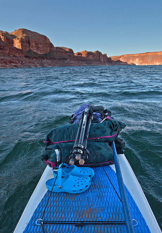 View from Colleen Miniuk-Sperry's inflatable stand-up paddleboard during high winds and swells near the Tapestry Wall (visible on top right, mile 110) on Lake Powell in the Glen Canyon National Recreation Area, Utah