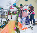 Becca Moen, left, and Sallie Hardy build a snowman in Oxford, Miss., on Monday, January 10, 2011. (AP Photo/Oxford Eagle, Bruce Newman)