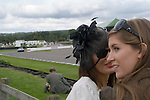 Goodwood Festival of Speed. Goodwood Sussex. UK Girls whispering.