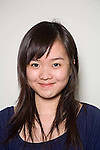 Chinese female 21 years old smiles in headshot