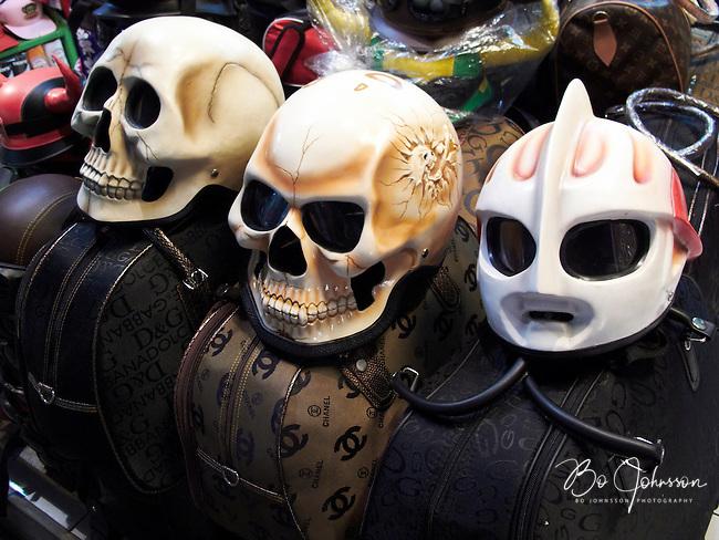 Motorcycle helmets. In a shop in Kuta, Bali, Indonesia.<br /> July 2009.