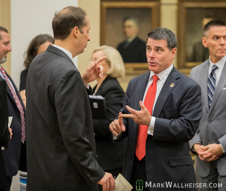 Bill Schifino, right, president of the Florida Bar, talks with Senate President Joe Negron in the courtroom prior to the investiture of the Honorable Alan Lawson as the 86th Justice of The Supreme Court of Florida in Tallahassee, Florida