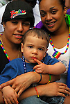 Gay and Lesbian pride parade, Gender and sexual identity and orientation, Hispanic Lesbian couple with child watching parade