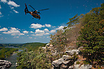 Maryland State Police helicopter rescue team setting up to hoist up fallen hiker from Maryland Heights