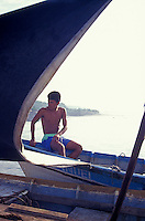 Young fisherman on the town pier in La Libertad, El Salvador