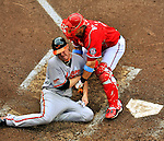 19 June 2011: Washington Nationals' catcher Wilson Ramos gets Chris Jakubauskas out at the plate during 5th inning action against the Baltimore Orioles at Nationals Park in Washington, District of Columbia. The Orioles defeated the Nationals 7-4 in inter-league play, ending Washington's 8-game winning streak. Mandatory Credit: Ed Wolfstein Photo