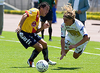UNAM Pumas midfielder Leandro Augusto (R) is fouled by Monarcas' Morelia Gustavo Trujillo during their soccer match at the University Stadium , March 12, 2006. UNAM PUMAS won 1-0 to Monarca's Morelia. © Photo by Javier Rodriguez