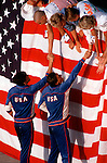 With a giant American flag as a background, American Swimmers are congradulated following a race at the 1984 Los Angeles Olympics