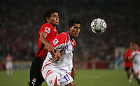 Egypt's Salah Soliman (2) pushes against Costa Rica's Josue Martinez (17) during the FIFA Under 20 World Cup Round of 16 match between Egypt and Costa Rica at the Cairo International Stadium on October 06, 2009 in Cairo, Egypt.