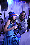 Fabulous MC David Waterman of Total Entertainment leads a happy Bat Mitzvah girl in song  at her party in Westchester, New York.