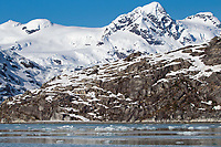 Snow covered Kenai mountains and the glacially carved shores of Nellie Juan Lagoon in Prince William Sound, Alaska.