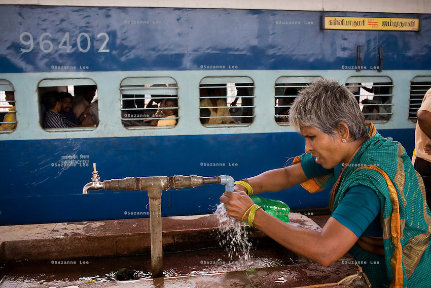 Train passengers get off to refill their drinking water bottles at Erode Junction stn., a 20 minute stop for the Himsagar Express 6318 in Tamil Nadu on 9th July 2009.. .6318 / Himsagar Express, India's longest single train journey, spanning 3720 kms, going from the mountains (Hima) to the seas (Sagar), from Jammu and Kashmir state of the Indian Himalayas to Kanyakumari, which is the southern most tip of India...Photo by Suzanne Lee / for The National
