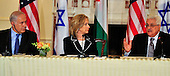 "United States Secretary of State Hillary Rodham Clinton, center, listens as President Mahmoud Abbas of the Palestinian Authority, right, makes remarks at the ""Relaunch of Direct Negotiations Between the Israelis and Palestinians"" in the Benjamin Franklin Room of the U.S. Department of State on Thursday, September 2, 2010.  Prime Minister Benjamin Netanyahu is at left..Credit: Ron Sachs / CNP.(RESTRICTION: NO New York or New Jersey Newspapers or newspapers within a 75 mile radius of New York City)"