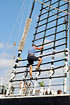 Man climbing shroud on tall ship Kruzenshtern