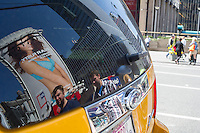 A reflection of a billboard in a taxi rear view window  advertising the JCPenney department store seen in Midtown Manhattan in New York on Tuesday, April 9, 2013.  JCPenney recently dismissed its CEO Ron Johnson and is replacing him with Johnson's predecessor Mike Ullman.  (© Frances M. Roberts)
