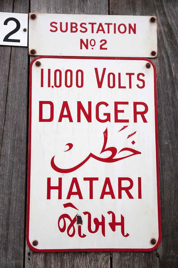 Stone Town, Zanzibar, Tanzania.  Multi-lingual sign on an electrical transformer attests to the multi-cultural nature of today's Zanzibar society.