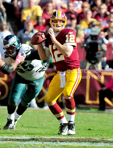 Washington Redskins quarterback John Beck (12) looks for a receiver in the fourth quarter against the Philadelphia Eagles at FedEx Field in Landover, Maryland on Sunday, October 16, 2011.  The Eagles won the game 20 - 13..Credit: Ron Sachs / CNP