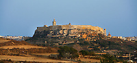 General view of the Citadella, Victoria, Gozo, Malta, pictured on June 2, 2008, in the afternoon. The Republic of Malta consists of seven islands in the Mediterranean Sea of which Malta, Gozo and Comino have been inhabited since c.5,200 BC. Nine of Malta's important historical monuments are UNESCO World Heritage Sites, including the Citadella, which has been a fortified city since the Bronze Age. Sited on a hill above Victoria (or Rabat) which dominates the surrounding countryside and coast, it was built up by the Phoenicians and then the Romans into a complex Acropolis. In the Middle Ages the Citadel was used as a refuge for the population by the Order of the Knights of St John. In 1551 the island was attacked by Muslims and the population taken away into slavery. Most of the remaining architecture is military although some fine examples of Maltese Baroque were constructed over the military settlement, including the 17th century Cathedral. Picture by Manuel Cohen.