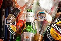 Glass Bottles in Recycling Bin.