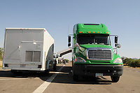 """Nogales, Arizona - A Border Patrol vehicle (left) utilizing mobile X-ray technology and operated by a CBP inspector analyzes the contents of this semi-truck at a permanent traffic checkpoint located on highway Interstate 19, north from Nogales and near the Town of Tubac, Arizona. """"See-through"""" mobile X-Ray units allow officers to get a picture of the contents of a vehicle being searched. Border Patrol checkpoints serve as inspection stations to detect illegal immigration and drug smuggling. Border Patrol agents assigned to fixed traffic checkpoints have wide discretion to stop vehicles for brief questioning and inspection of its occupants and its contents. This checkpoint is part of the Border Patrol Tucson Sector. Photo by Eduardo © 2012"""