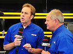 May 6, 2012; Commerce, GA, USA: NHRA ESPN Host, Mike Dunn (left) with XXXX during the Southern Nationals at Atlanta Dragway. Mandatory Credit: Mark J. Rebilas-