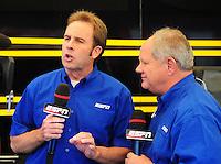May 6, 2012; Commerce, GA, USA: NHRA ESPN Host, Mike Dunn (left) with XXXX during the Southern Nationals at Atlanta Dragway. Mandatory Credit: Mark J. Rebilas-