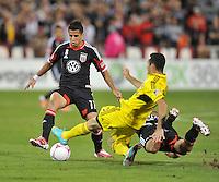 D.C. United midfielder Marcelo Saragosa (11) goes against Columbus Crew midfielder Justin Meram (9) D.C. United defeated The Columbus Crew 3-2 at RFK Stadium, Saturday October 20, 2012.