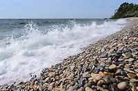 A Lake Michigan wave crashing ashore at historic Slag Beach, Fayette Historic State Park.