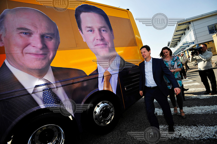 Liberal Democrat party leader Nick Clegg on the election campaign trail in Norfolk. After stopping at a Morrison's supermarket in Norwich, he returns to his battle bus.