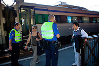Switzerland. Canton Ticino. Chiasso. Railway station. The border guards are checking the identity cards from passengers arriving on a train from Italy. The young man (R) had legal paper and enterered Switzerland without problems. About 90 per cent of illegal immigrants who want to get into Switzerland try their chance by train. No specific measures are yet planned by the border guards, but an emergency, reinforcements from other parts of Switzerland is dispatched in Ticino as prevention to a potential massive arrival of economic migrants. 08.04.11 © 2011 Didier Ruef