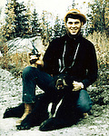 Ron Bennett photographer and the black bear he shot in Alaska.