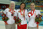 Canadians swept the podium in women's 100 metre butterfly S13 action at the Paralympic Games in Beijing, Sunday, Sept., 7, 2008.  From left, Chelsey Gottell of Hamilton, Ont. took the bronze, Valerie Grand'maison of Montreal with gold and silver medalist Kirby Cote of Winnipeg.   Photo by Mike Ridewood/CPC