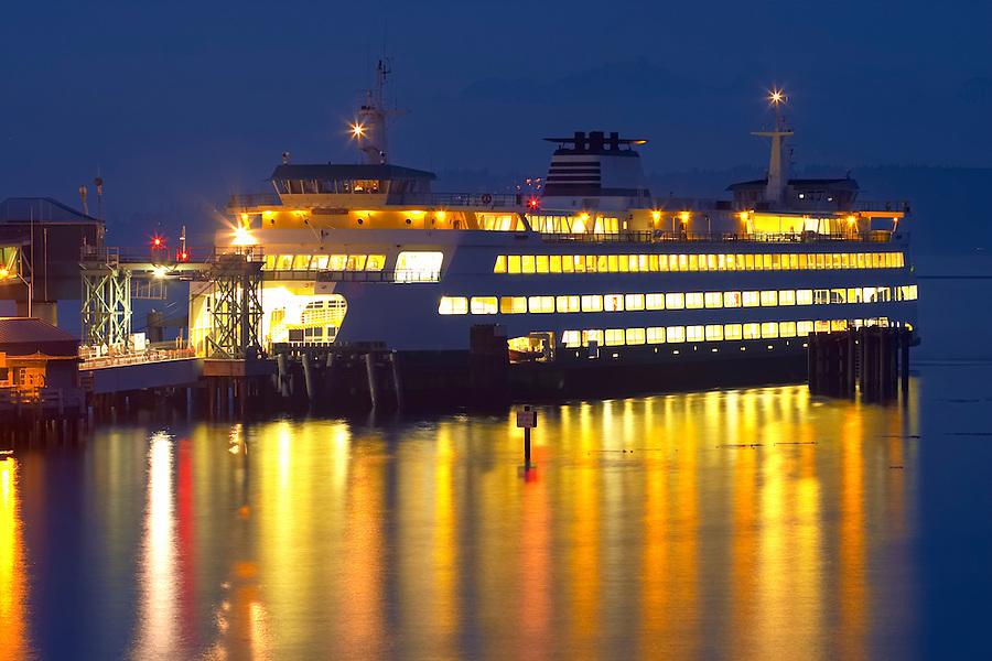 Washington State ferry Puyallup pulling into dock at night, Edmonds, Snohomish County, Washington, USA