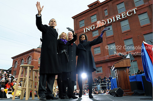 Wilmington, DE - January 17, 2009 -- United States President-elect Barack Obama (L) Vice President Joe Biden (2nd-R), Obama's wife Michelle (R), and Biden's wife Jill wave following a rally in Wilmington, Delaware, where Obama picked up Biden on the Whistle Stop Train Tour, on Saturday, January 17, 2009. The ceremonial trip will carry President-elect Obama, Vice President-elect Biden and their families to Washington for their inaugurations with additional events in Philadelphia, Wilmington and Baltimore. Obama will be sworn in as the 44th President of the United States of January 20, 2009. .Credit: Kevin Dietsch - Pool via CNP
