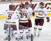 Philip Samuelsson (BC - 5), Steven Whitney (BC - 21), Bill Arnold (BC - 24), Patrick Wey (BC - 6) and Paul Carey (BC - 22) celebrate Whitney's goal. - The Boston College Eagles defeated the visiting Boston University Terriers 5-2 on Saturday, December 4, 2010, at Conte Forum in Chestnut Hill, Massachusetts.