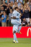 Graham Zusi (8) of Sporting Kansas City celebrates his goal with teammate Kei Kamara (23) during the game at Livestrong Sporting Park in Kansas City, Kansas.  D.C. United lost to Sporting Kansas City, 1-0.