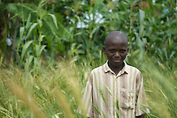 Winston stands in his first wheat crop. Behind maize and banana plantation, the more usual crops of Ugandan farmers. Winston used an SMS information service from Grameen's Applab to find out how wheat could be grown in his family's area. Despite a fertile soil and good climate there is often little innovation from small farmers' choice of crop or technique.  Farmers who diversify typically improve their food secuity as well their income.