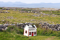 Leprechaun house near the Dun Aonghasa Fort, Inis Mór, Aaran Islands, County Galway, Ireland..The island of Inis Mór ( meaning the big island) is one of the most popular tourist destinations in Ireland. The islands inland landscape of uniquely blanketed rock surface are glazed with man made rock walls that meander and cross all directions as far as one can see. Well known internationally, it is steeped in history and resembles an outdoor museum with over 50 different monuments of Christian, pre Christian and Celtic mythological heritage. Picture James Horan