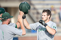 Eastern Michigan Eagles outfielder Mike Mioduszewski (15) is greeted by teammates after hitting a home run during the NCAA baseball game against the Michigan Wolverines on May 16, 2017 at Ray Fisher Stadium in Ann Arbor, Michigan. Michigan defeated Eastern Michigan 12-4. (Andrew Woolley/Four Seam Images)