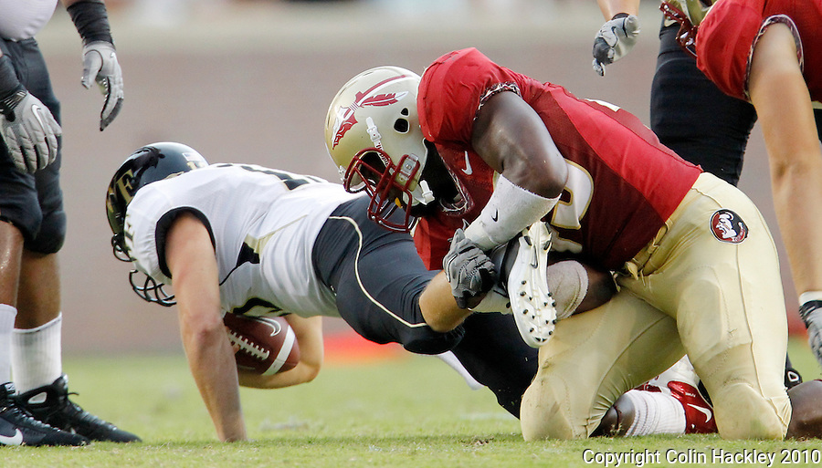 TALLAHASSEE, FL 9/25/10-FSU-WF FB10 CH-Florida State's Brandon Jenkins shoe string tackles Wake Forest's Ted Stachitas during second half action Saturday at Doak Campbell Stadium in Tallahassee. The Seminoles beat the Demon Deacons 31-0..COLIN HACKLEY PHOTO