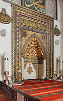 Mihrab of the Grand Mosque or Ulu Cami, built 1396-99 under the Ottoman Sultan Bayezid I by the architect Ali Neccar in the Seljuk style, Bursa, Turkey. The mosque is a large rectangular building with 2 minarets, and 20 domes supported by 12 columns. Supposedly the 20 domes were built instead of the 20 separate mosques which Sultan Bayezid I had promised for winning the Battle of Nicopolis in 1396. The dome over the sadirvan is capped by a skylight creating a soft light which illuminates the large building. The mosque is in the old city centre of Bursa and remains the largest mosque in the city. Picture by Manuel Cohen