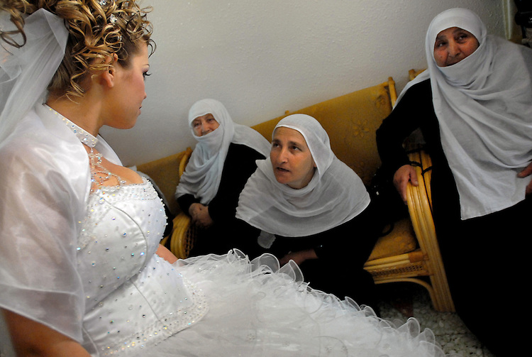 Arwad Abu Shaheen, left, and her relatives during a farewell gathering at Arwad's house in Bukata, Golan Heights, before she is set off to marry her fiancé in Syria.