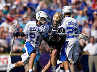 Zach Howell (21) of Duke uses a pick from teammate Ned Crotty (22) to free himself from Kevin Randall (39) of Notre Dame during the NCAA Men's Lacrosse Championship held at M&T Stadium in Baltimore, MD.  Duke defeated Notre Dame, 6-5, to win the title in overtime.