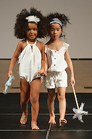 Model walks runway in an outfit by the Wild and Fierce Childrenswear collection, during the petitePARADE Children's Club fashion show at the Jacob Javits Center in New York City, on January 9, 2016.